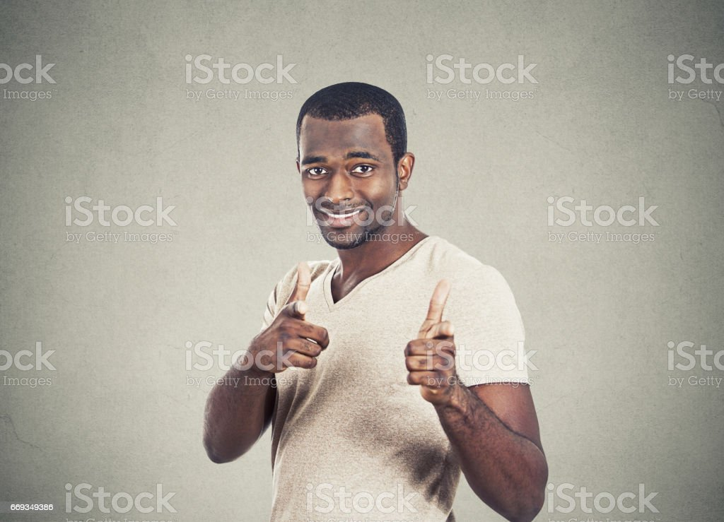 young casual man with two hands guns sign gesture pointing at you camera stok fotoğrafı