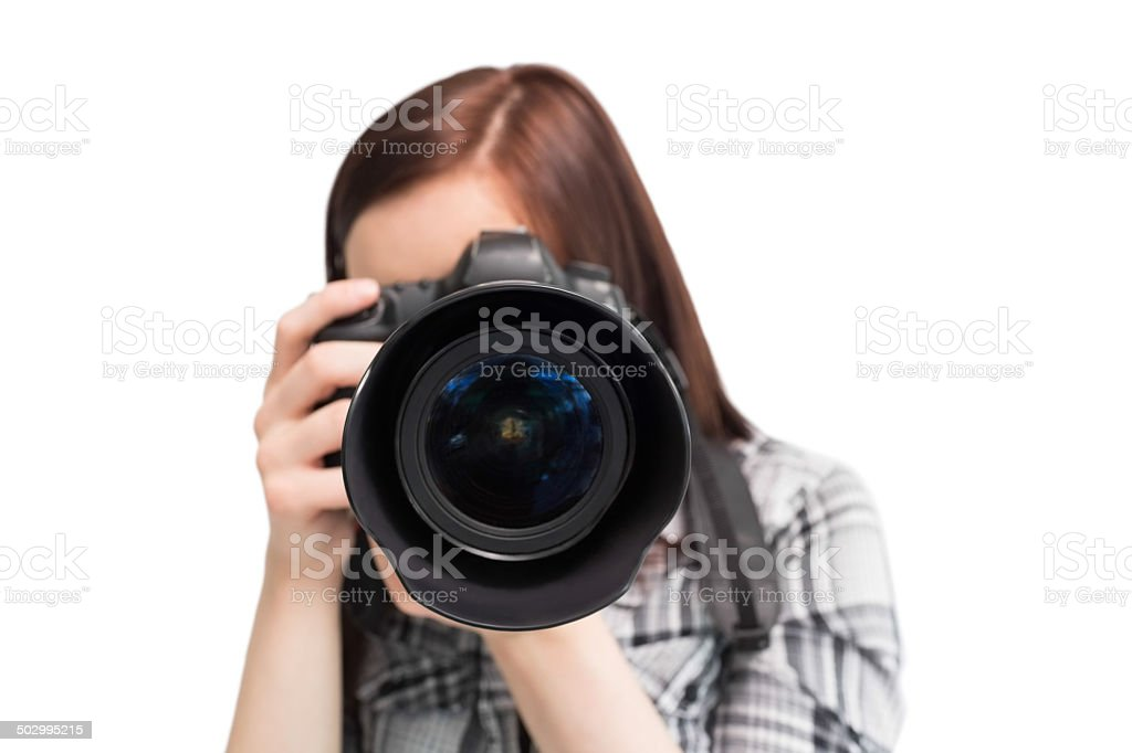 Young casual photographer taking picture of camera stock photo