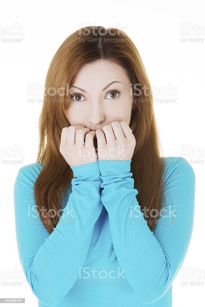 Young casual woman is eating her nails. royalty-free stock photo
