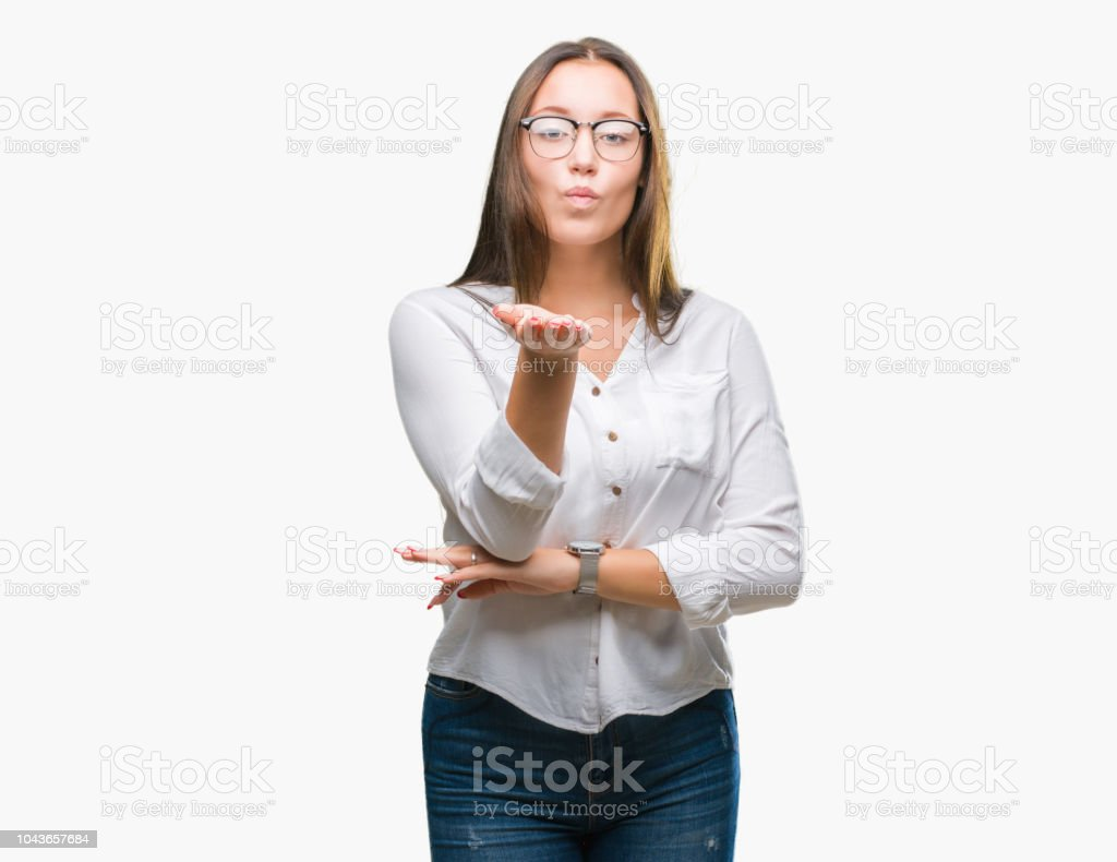 Young caucasian beautiful business woman wearing glasses over...