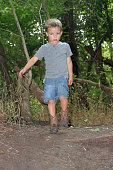 istock Young caucasian blond male boy, outside at public park 1253837622