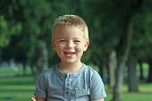 istock Young caucasian blond male boy, outside at public park 1253837666
