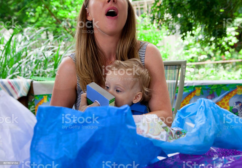 Young Caucasian boy celebrates his first birthday with his Mothe stock photo