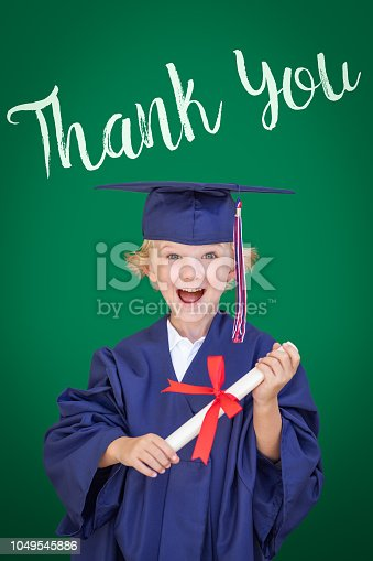 istock Young Caucasian Boy In Graduation Cap and Gown Against Green Chalkboard Background With Thank You 1049545886