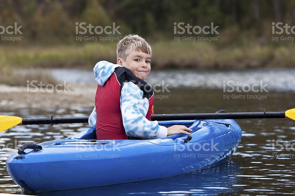 Young Caucasian Boy Kayaking stock photo
