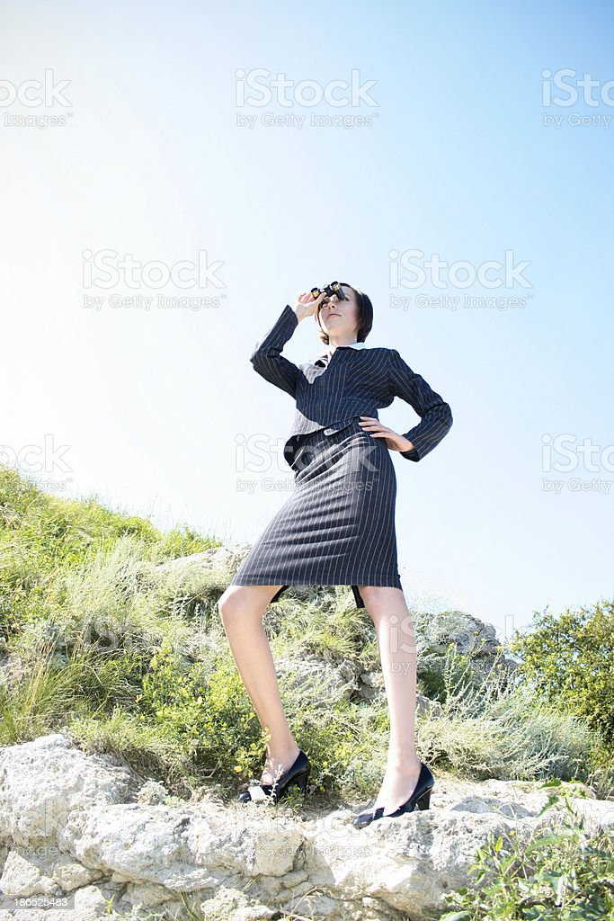 Young caucasian business lady with binoculars royalty-free stock photo