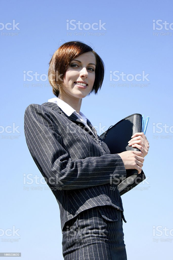 Young caucasian business lady with folders royalty-free stock photo