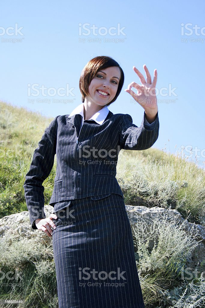 Young caucasian business lady with okay royalty-free stock photo