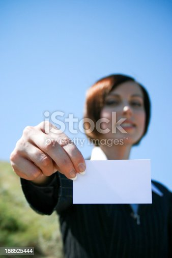 Young Caucasian Business Lady With Sheet Of Paper Stock Photo & More Pictures of Adult