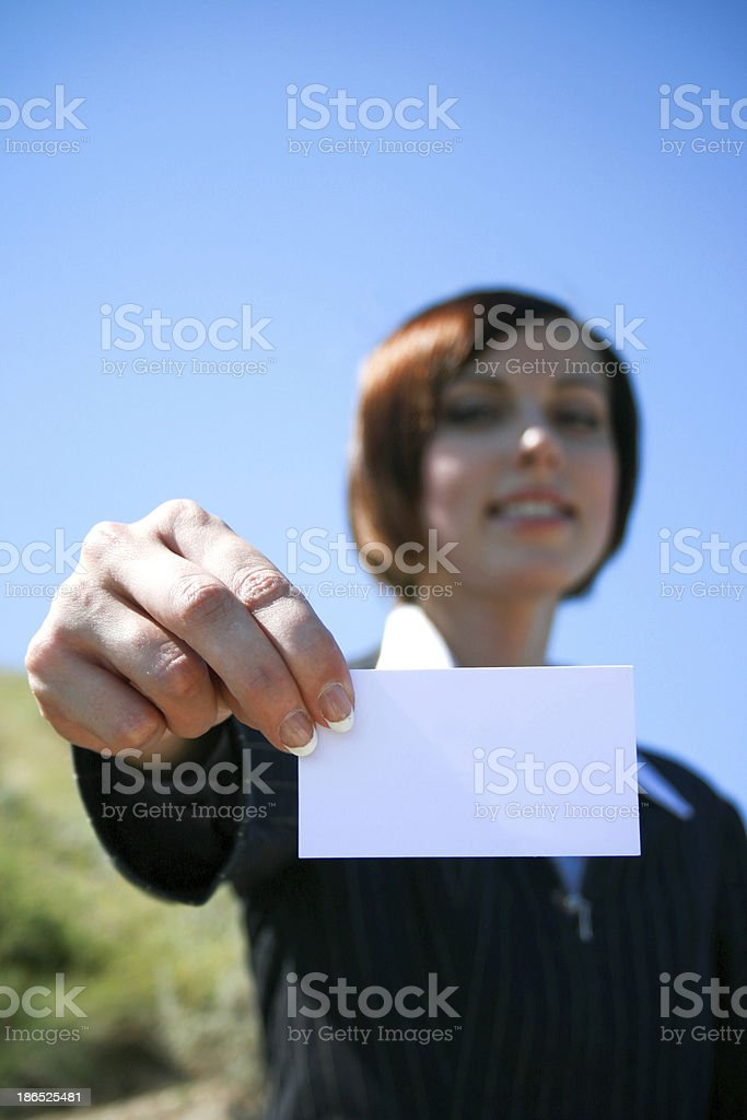 Young caucasian business lady with sheet of paper royalty-free stock photo