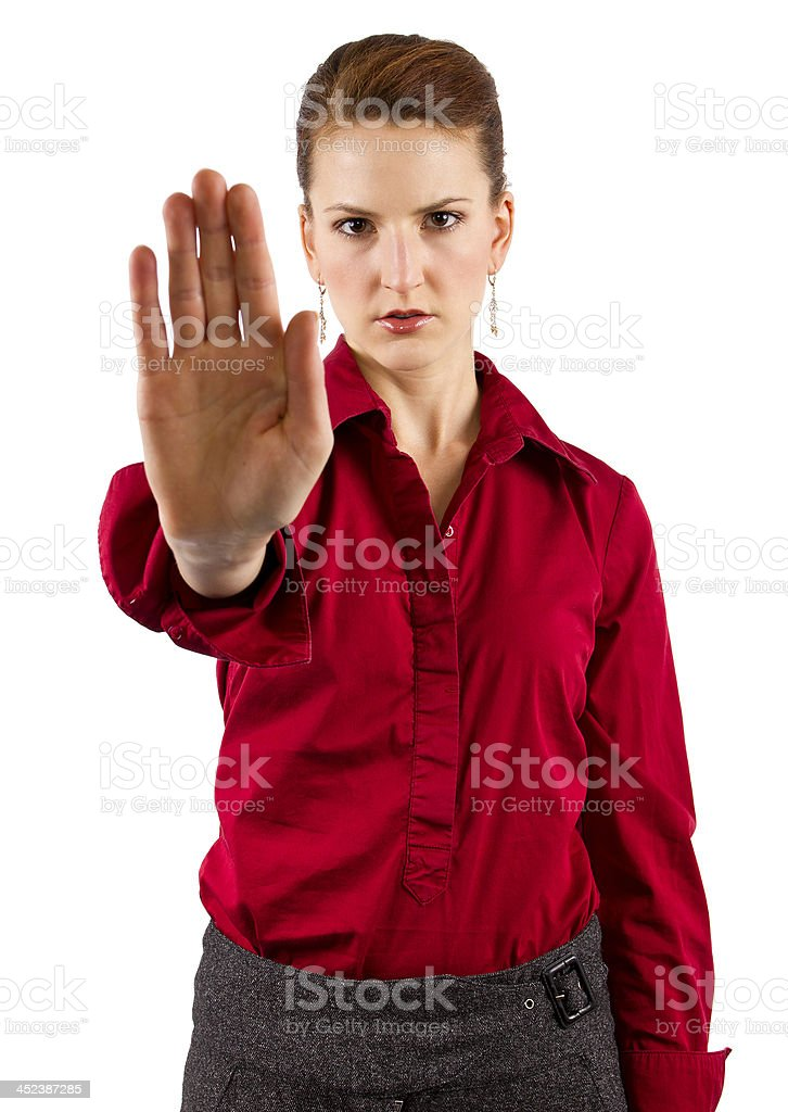 Young Caucasian Businesswoman Holding Hand Up to Stop royalty-free stock photo