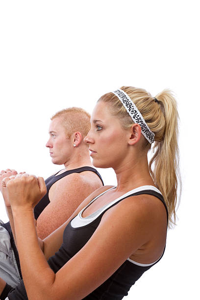 Young caucasian couple doing sit-ups stock photo