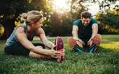 istock Young caucasian couple exercising in park 640351570