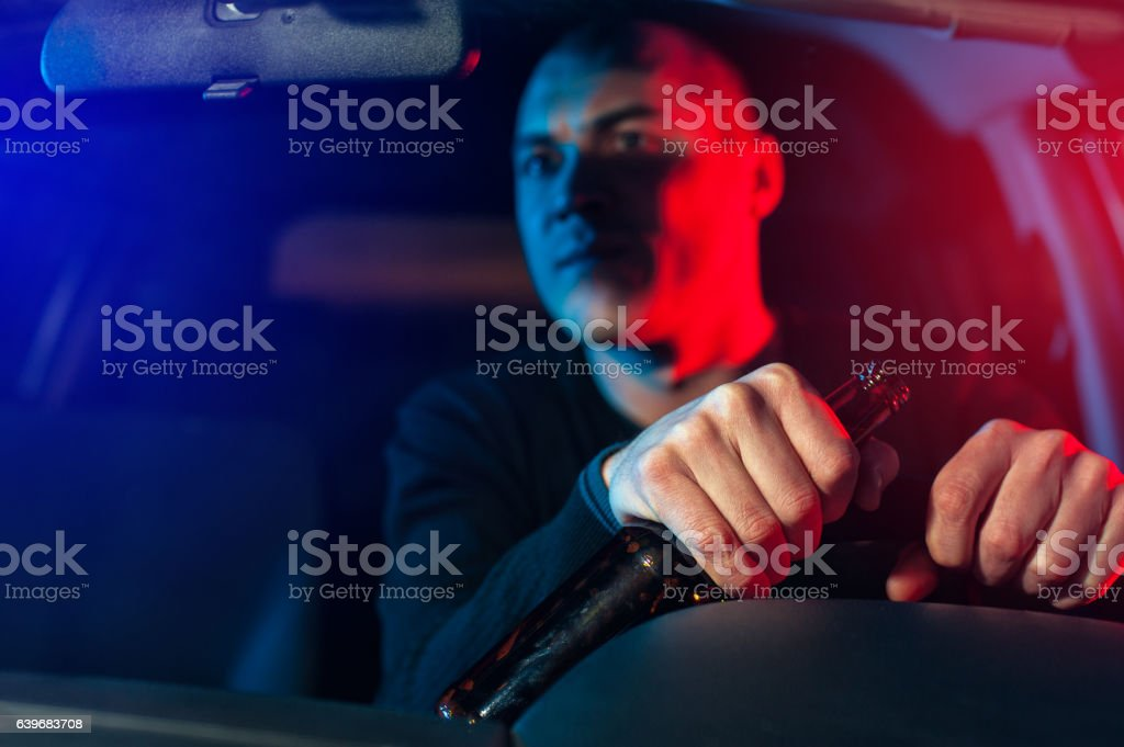 Young caucasian drunk man in auto chased by police stock photo