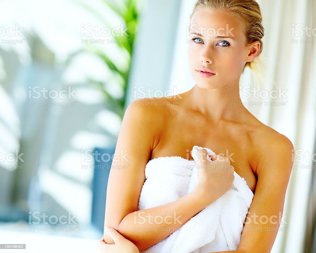Young Caucasian female wrapped in towel royalty-free stock photo
