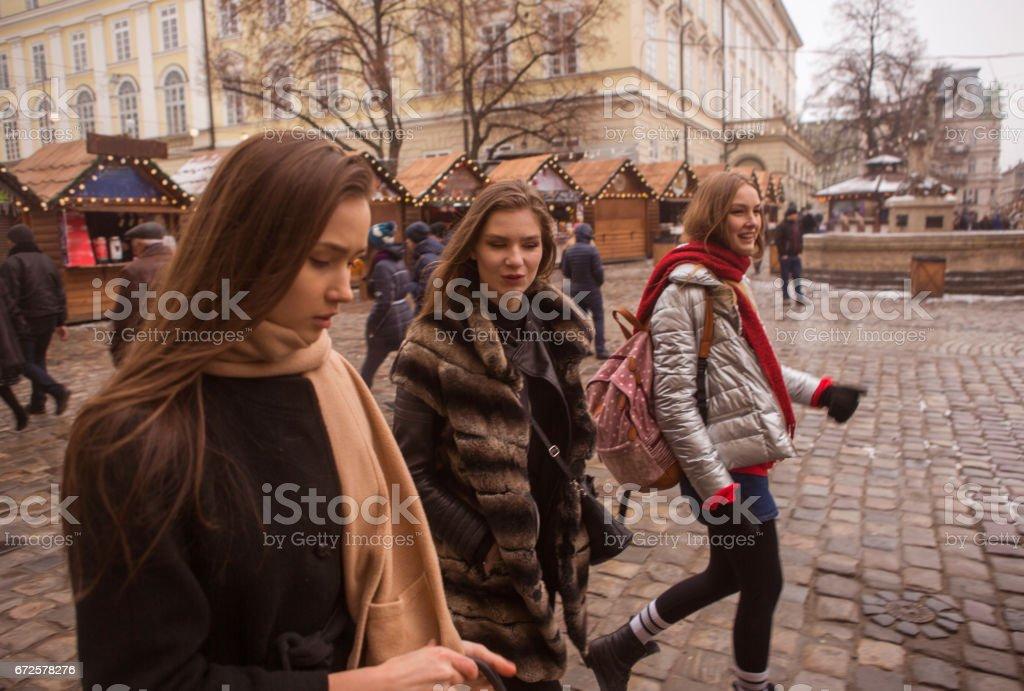 Young caucasian girl models walking at street of lviv ukraine stock photo