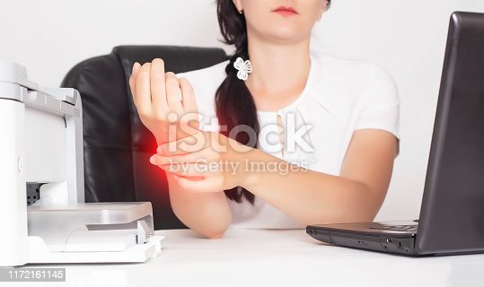 668285874istockphoto Young caucasian girl office worker holds on wrist joint pain and inflammation concept in hand, tunnel syndrome, businesswoman 1172161145