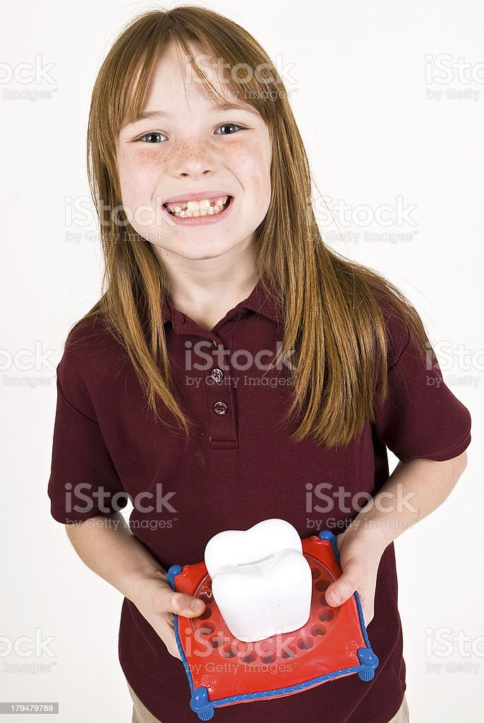 Young caucasian girl waiting on the tooth fairy stock photo
