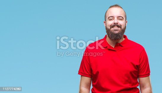 Young caucasian hipster man wearing red shirt over isolated background with a happy and cool smile on face. Lucky person.