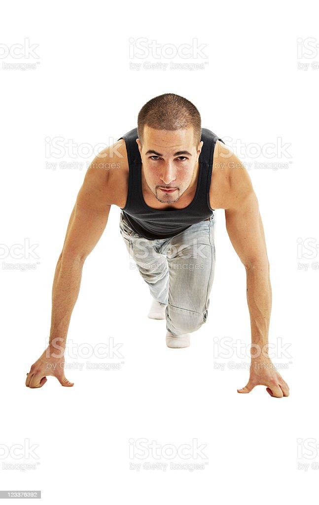 Young Caucasian male in starting position for a race royalty-free stock photo