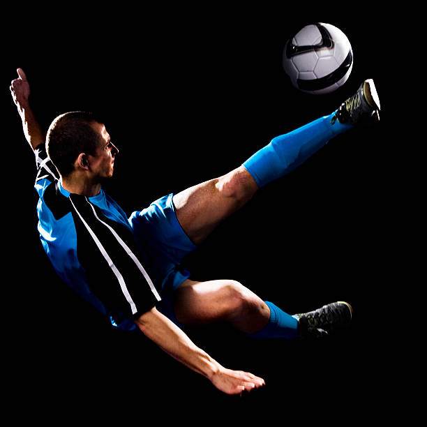 Young Caucasian Male Making Soccer Bicycle kick stock photo