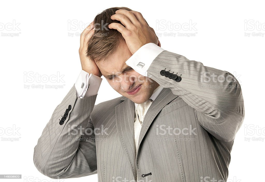 Young Caucasian man holding his head in despair royalty-free stock photo