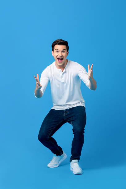 Young caucasian man in surprised gesture stock photo