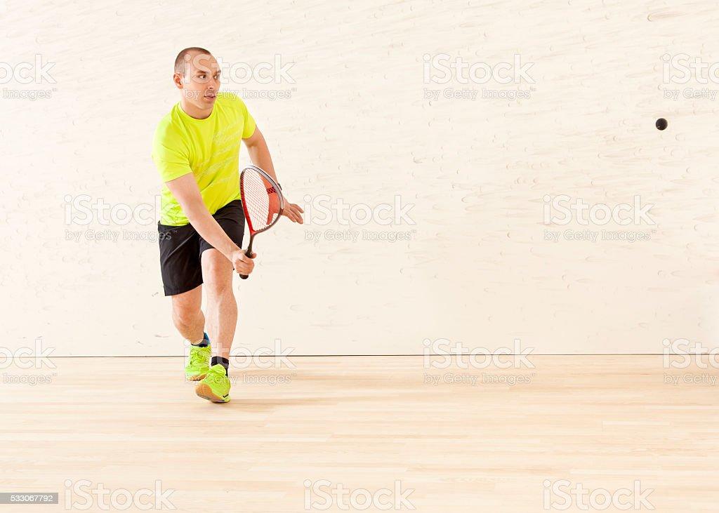 Young Caucasian man playing squash stock photo