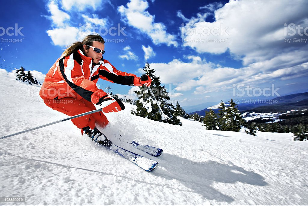 Young Caucasian man skiing on a slope royalty-free stock photo