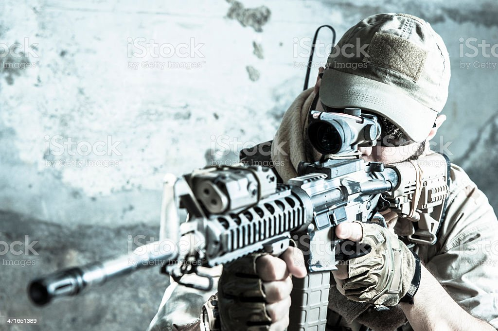 Young Caucasian Modern Army Soldier Shooting with Assault Rifle stock photo