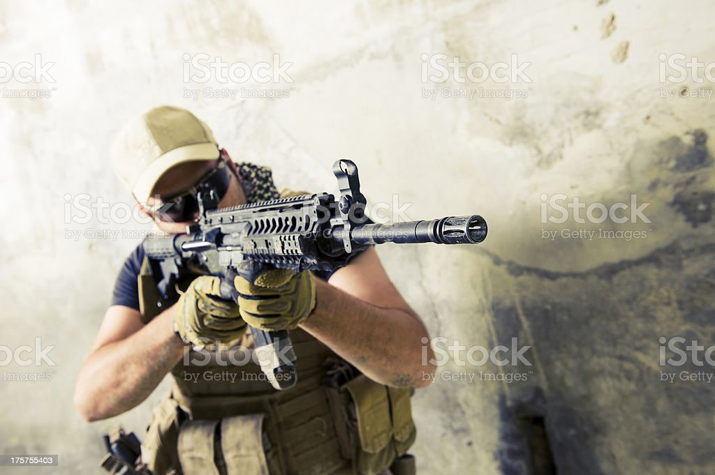 Young Caucasian Modern Contractor Soldier Shooting with Assault Rifle stock photo