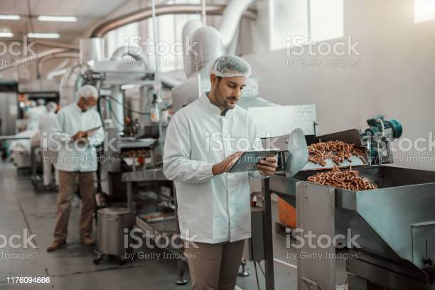 Young caucasian serious supervisor evaluating quality of food in food picture id1176094666?b=1&k=6&m=1176094666&s=612x612&h=3bphf t 3nzrrwby5ab3cqsdtz xbbitkssigjl7ssa=