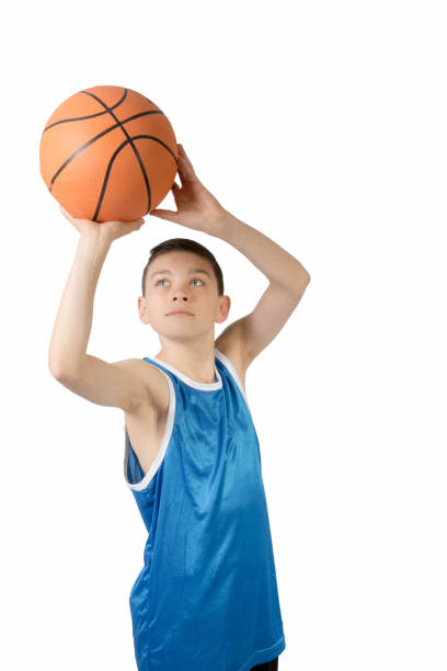 Young caucasian teenage boy with a basketball stock photo