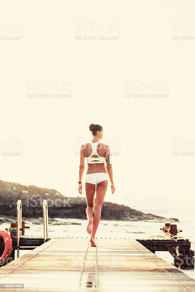 Young caucasian white woman walking on the quay stock photo