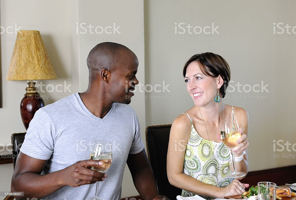Young Caucasian Woman and Colored Man in Restaurant royalty-free stock photo