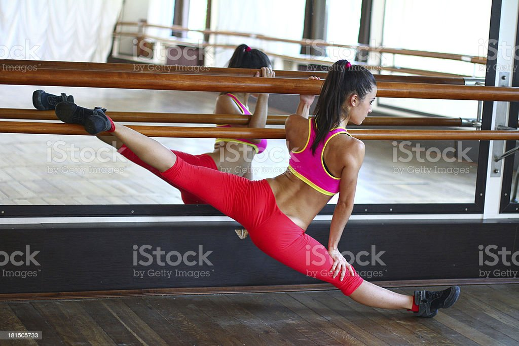 Young caucasian woman dancer near the mirror royalty-free stock photo