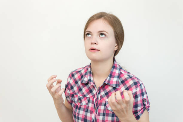 Young caucasian woman girl with confused, annoyed, frustrated, irritated look expression Young caucasian woman girl with confused, annoyed, frustrated, irritated look expression rolling eyes stock pictures, royalty-free photos & images