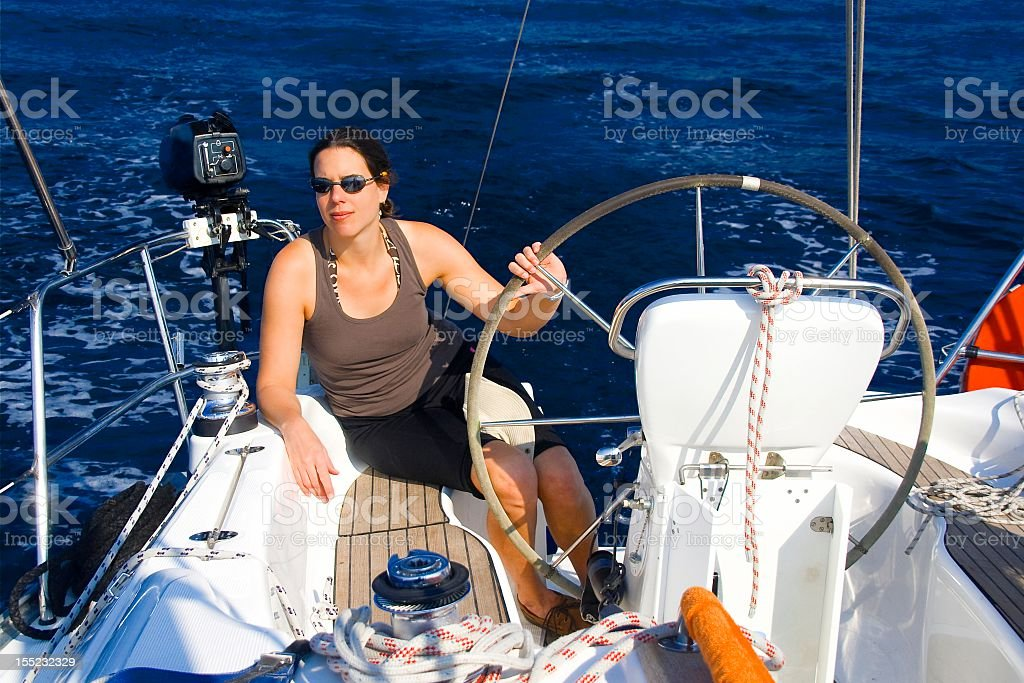 Young Caucasian woman on a sailing boat stock photo