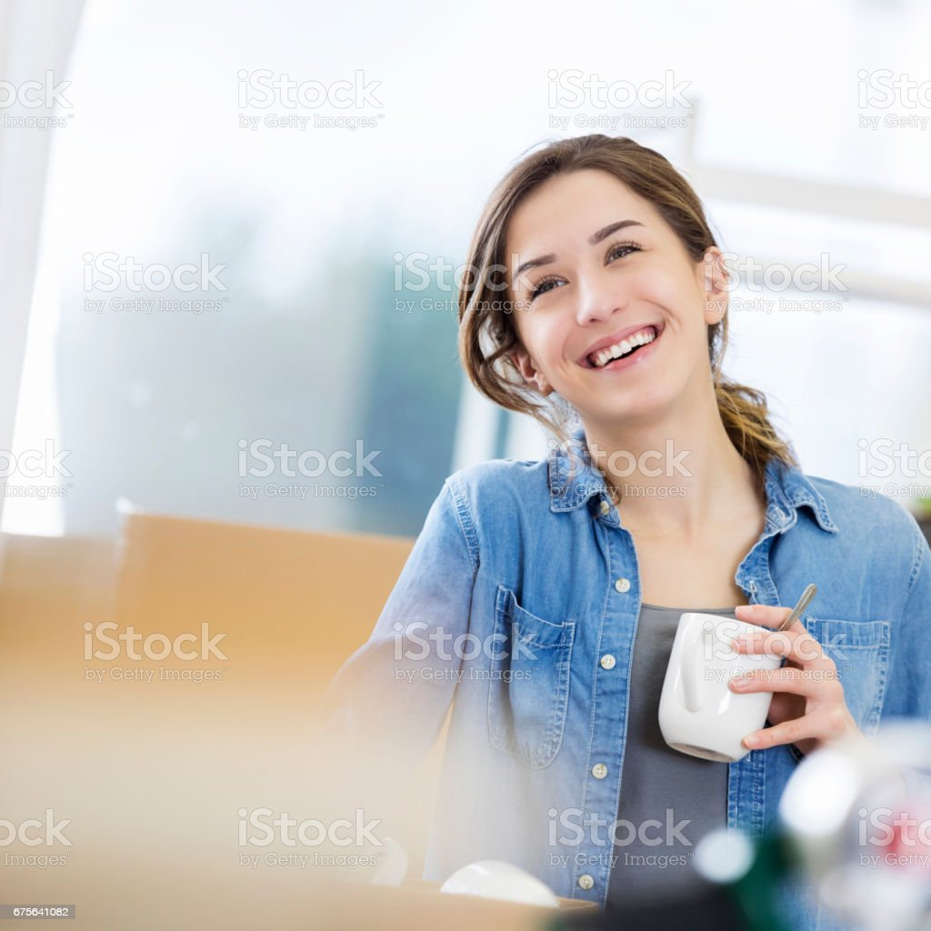 Young Caucasian woman packs up her home royalty-free stock photo