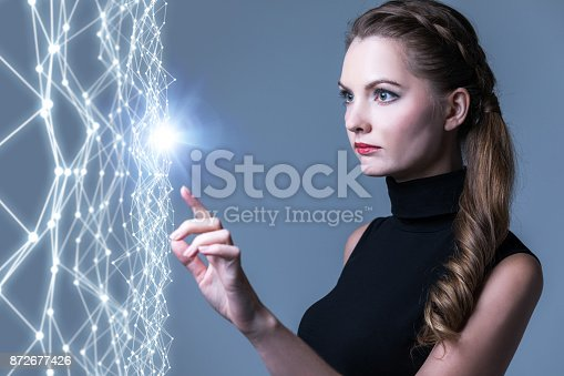 872677426 istock photo Young caucasian woman pointing wire mesh network concept. 872677426