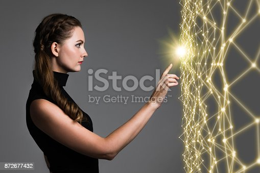 872677426 istock photo Young caucasian woman pointing wire mesh network concept. 872677432