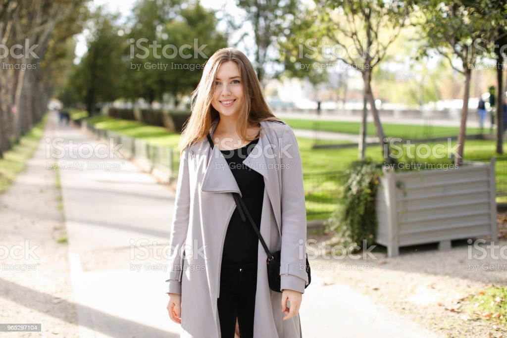 Young caucasian woman walking in city and enjoying spring weather zbiór zdjęć royalty-free