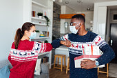 istock Young Caucasian woman welcoming her African American friend to her home 1280104660