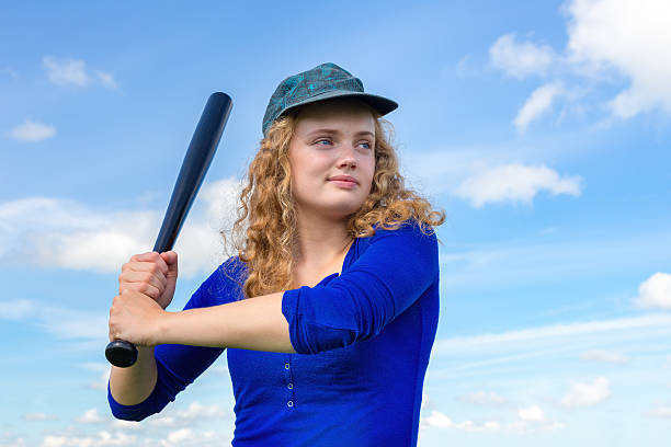 young caucasian woman with baseball bat and cap - ソフトボール ストックフォトと画像