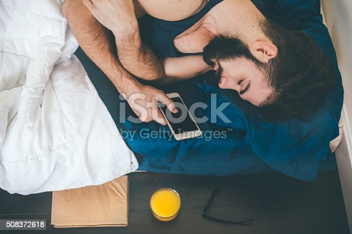 Man sleeping whit mobile phone in hands