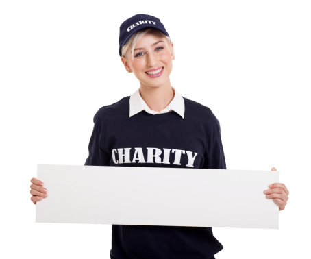 1166716628 istock photo young charity worker holding blank white board 477593841