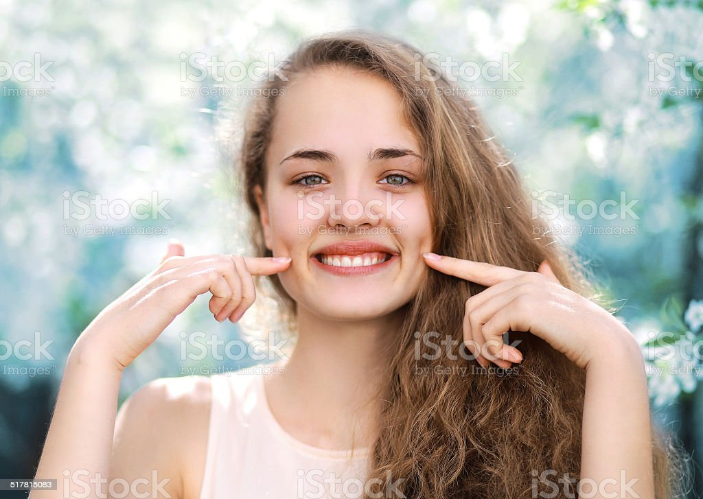 Young charming funny girl cute smiling with dimpled stock photo