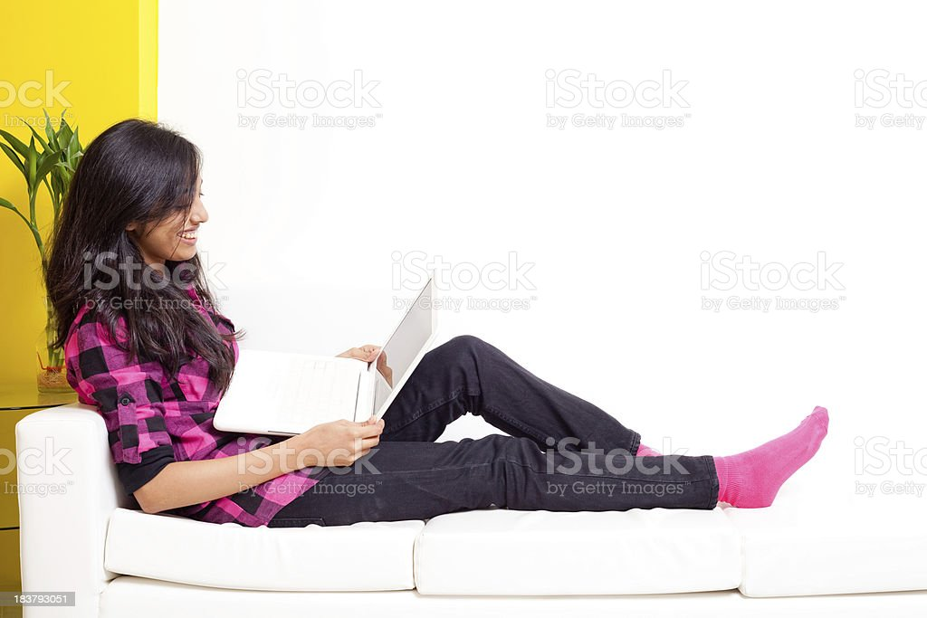 Young Cheerful Attractive Indian Adult Female working on Laptop royalty-free stock photo