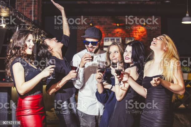 Young cheerful company of friends in the club bar having fun with in picture id907421116?b=1&k=6&m=907421116&s=612x612&h=g9ciruxe7fwgav9zr5gc141kwvsrtvny7z9ew 1rt0q=