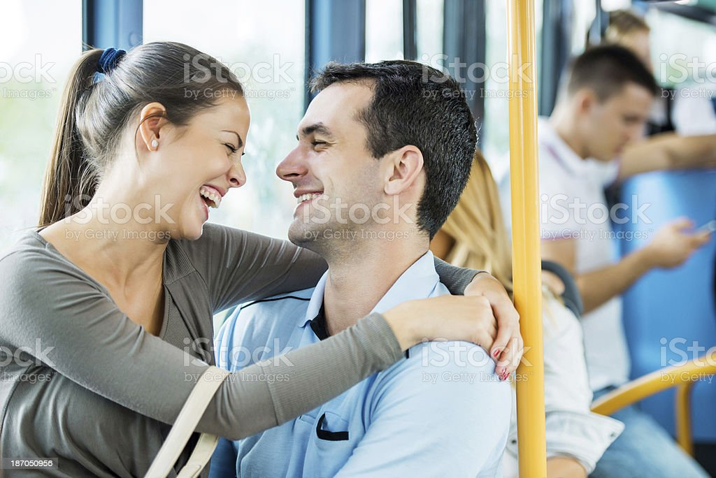 Young cheerful couple on the bus. royalty-free stock photo